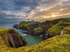 Fanad Lighthouse (explored) (Alan10eden) Tags: morning autumn ireland light sea lighthouse seascape canon landscape dawn coast early october rocks view hill wideangle cliffs shore rugged donegal 1022 daybreak ulster fanad northatlantic alanhopps