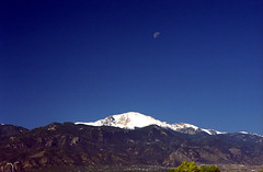 First Snow, Last Quarter (tarkushoo) Tags: blue sky moon mountain snow mountains film 35mm gold nikon kodak peak front 200 pikes rockymountains 135 range lunar fe2