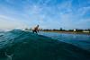 Down the line (Lost Odyssey) Tags: ocean shells beach water sunrise rocks surf waves florida barrel paddle wave surfing atlantic surfboard tropical surfers reef skimboard
