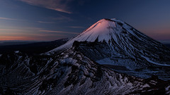 A Touch of Warmth (blue polaris) Tags: park new morning travel blue red snow sunrise landscape island dawn volcano spring scenery mt crossing walk plateau great north central olympus mount zealand alpine national crater hour tongariro volcanic ngauruhoe omd 2014 em5