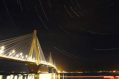 the startrails project (sbouboux) Tags: bridge rio night photography long exposure hellas greece startrails patras  charilaostrikoupis    sbouboux