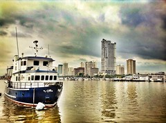Boat on the water (mikeeliza) Tags: light sky art public water clouds photography reflecting bay ship philippines dramatic manila ripples mikeeliza