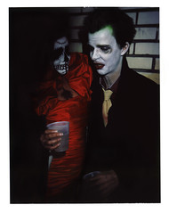 Lucas and the Woman in Red (emilyearl) Tags: brick film halloween polaroid mysterious instant fujifilm savannahga sugarskull intheshadows peacockfeather polaroidpropack thejoker thejinx fp100c thewomaninred redsilkdress emilyearlphotography latenightpolaroids juleshoughton