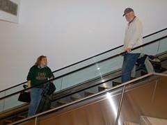 David and Peggy on the escalator (JuneNY) Tags: buffalotojfk new york airports buffalonewyork delta buffalointernationalairport erie county airport