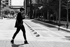 Smoking In Crossing (burnt dirt) Tags: houston texas downtown town city mainstreet street sidewalk streetphotography fujifilm xt1 office building bw blackandwhite girl woman people person crosswalk traffic shorthair smoking cig cigarette walking phone cellphone headphones texting purse bag