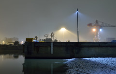 Dock (Kojaniemi) Tags: flood floodlight crane dock pier ship boat snow snowing sleet sleeting nightphotography bynight night river kimmoojaniemi longexposure riverbank turret guntower minesweeper streetlight radar water harbor harbour nightonearth