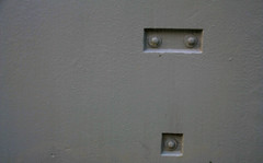 whoa (Jen_Vee) Tags: wall board marquee gray paint bolts face recessed simple minimal shocked