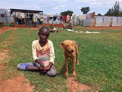 Susie taking a break from dancing around the compound to hang out with the worlds friendliest guard dog. #preciouskidscenter