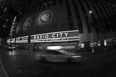 Radio City Music Hall (kent.c) Tags: kentckentcphotography canon canon5dmarkiii 5dmarkiii 2016 nyc ny newyorkcity radiocity manhattan usa us unitedstatesofamerica bw blackandwhite blackandwhitephotograph taxi radiocitymusichall rockefellercenter entertainmentvenue themadisonsquaregardencompany fisheye canonfisheye musichall