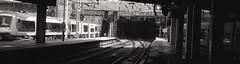 converging (OhDark30) Tags: olympus 35rc 35 rc 35mm film monochrome bw blackandwhite bwfp fomapan 200 rodinal birmingham newst station rail railway trains platform pano panoramic tunnel tunnelvision