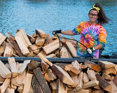 Volunteer Jessica Paiva prepares the wood boats at Dyer Street access dock (Photograph by Drew Christhilf) (waterfireprov) Tags: volunteer woodboat