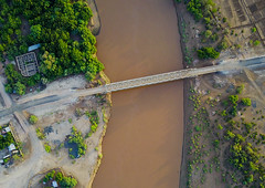 Aerial view of the metal bridge over Omo river, Omo Valley, Omorate, Ethiopia (Eric Lafforgue) Tags: above aerial aerialview africa architecture bridge colourpicture day developingcountry drone eastafrica ethdrone031754 ethiopia horizontal hornofafrica infrastructure kelem kurazworeda landscape loweromovalley metal metallic nature nopeople nobody omoriver omovalley omorate oromiya outdoors photography river riverbank steel tranquilscene traveldestinations trees water wild et