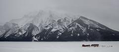 Bleakness of winter (chrisroach) Tags: lake frozen snow lakeminnewanka banff banffnationalpark hdr exposures mountains mountain rockies canadianrockies winter mist
