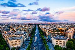 An evening view from Arc de Triomphe, Paris (karanmitra) Tags: arcdetriomphe paris color sunset cloud velvia nkon nikond40 landscape cityscape travel city building traffic europe hue sky tower