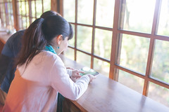 Happy female friends watching photos on digital tablet together in the morning (Apricot Cafe) Tags: img28608 1819years 3034years asia asianandindianethnicities cafe japan japaneseethnicity kyotojapan sigma35mmf14dghsmart bright casualclothing charming cheerful day digitaltablet enjoyment freedom friends happiness horizontal indoors lifestyles morning onlywomen photography rearview relaxation restaurant smiling springtime teenager togetherness twopeople waistup watching weekendactivities window women youngadult kyōtoshi kyōtofu jp