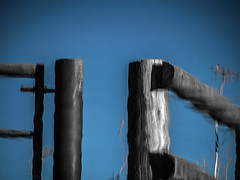 Fence reflection (fstop186) Tags: reflection water metal fence post timber metallic reflectsobsessions