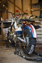 Australian Postie Bike Grand Prix (cnlkurtz) Tags: race canon honda 50mm shed performance workshop 5d custom evelknievel rothmans ct110 racetech paddockstand postiebike tyrewarmers australianpostiebikegrandprix