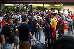 Umbrella Revolution #260 () Tags: road street leica city people umbrella hongkong freedom democracy movement day candid rangefinder stranger demonstration revolution conflict 40mm mongkok thug socialevent m9 summicronc f20 occupy mmount umbrellarevolution leicasummicronc40mmf20 leicam9 occupycentral umbreallarevolution