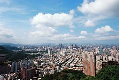Taipei Looking Northwest From Elephant Mountain (bluetrayne) Tags: city blue urban building green architecture clouds skyscraper landscape colorful asia cityscape cloudy taiwan sunny bluesky taipei blueskies taipei101