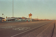 desert implosion. amboy, ca. 2014. (eyetwist) Tags: california road sunset color abandoned sign analog america point landscape evening vanishingpoint cafe route66 stencil nikon closed desert dusk 28mm grain wide motel wideangle icon ishootfilm 66 route highdesert mojave americana kicks shield lonely arrow 100 analogue grainy roadside nikkor googie vanishing desolate grainisgood vacancy coolscan manualfocus antenna golfball typology mojavedesert roys amboy implosion gloaming middleofnowhere cabins emulsion motherroad us66 f3hp 28mmf28ais adox eyetwist getyourkicksonroute66 bypassed f3t theicon filmexif filmtagger eyetwistkevinballuff colorimplosion