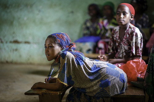 Nimo Abdu Kair, 8, takes notes during her class at Oda Aneso Primary School