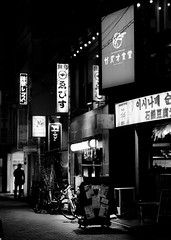 in the shadows, he waited patiently. (girltravel) Tags: bw japan tokyo blackwhite 6ws sixwordstory nightlife tokyo2014 mituckler