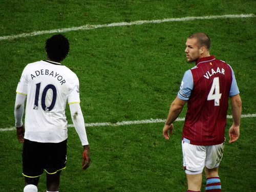 Tottenham Hotspur's Emmanuel Adebayor and Aston Villa's Ron Vlaar