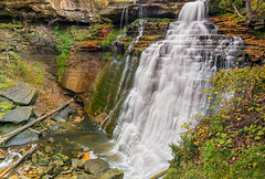 Brandywine Falls (Kenneth Keifer) Tags: longexposure autumn ohio cliff motion blur color fall nature water beautiful leaves creek landscape waterfall nationalpark october rocks colorful whitewater stream scenic blurred canyon foliage fallen cuyahoga gorge refreshing cascade cataract plunge cascading ledges brandywinefalls splashing plummet brandywine cuyahogavalley plunging