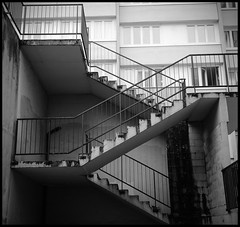 Urban stairs (TB35mm) Tags: urban bw 120 6x6 film monochrome analog rolleiflex mediumformat square blackwhite fuji streetphotography nb 150 rodinal 93 montreuil noirblanc acros 35f xenotar