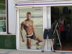 Well, well and well??? (Jean Bloor) Tags: male shop advertising poster model shiny underwear circus front torso shorts cala majorca millor