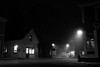 Mahone Bay Film Noir (Wroot Down) Tags: road street old city nightphotography travel light shadow urban blackandwhite bw white abstract black building art film silhouette fog mystery architecture night facade contrast vintage buildings dark walking outdoors lights town downtown noir moody cityscape novascotia view darkness dusk streetlights background empty dramatic atmosphere scene creepy sidewalk filmnoir mahonebay nikond600 nikkor2485mmf3545
