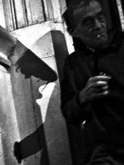 A Man and His Shadow (MAN) (bluephew) Tags: shadow contrast night monochrome cigarette 2017 winter darktable fuji fujix100t switzerland blackandwhite bw bnw street streetphotography streetart city town wow cool dark shadows light people smoke smoking face hand wall manatnightman 23mmapscsensor