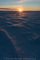 Winter Sunrise (burntpixel.ca) Tags: canada manitoba winnipeg photo photograph rural fine art patrick mcneill burntpixel wrench777 beautiful spectacular vertical sunrise sunset morning evening sunlight prairie sony a7r2 sonya7r2 canon 1740mm lake snow winter blue orange pink diagonal sunstar cold