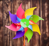 Colorful pinwheel on wooden background (L'Echoppe du Vent) Tags: pinwheel windmill closeup leisure nobody blow wood turbine freedom spin energy wind color free colorful blue toy multicolored motion generate childhood alternative joy background play child wooden renewable resource rainbow mill game green red yellow orange pink purple spiral portugal