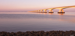 Sunset at the bridge (moniquevantorenburg) Tags: sunset zonsondergang zeelandbrug cl colijnsplaat bridge brug long sunsetlight nederland thenetherlands olympus124028pro olympusomdem5markii m43 mirrorless microfourthirds mft moniquevantorenburg