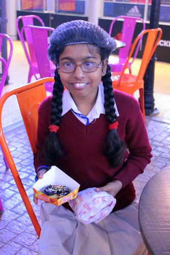 KidZania Tour for Kids with disabilities: One girl from the group with the donut and burger she made herself!
