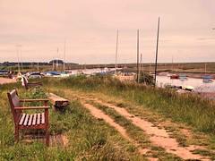 007 Seat with a view (saxonfenken) Tags: 6798land 6798 burnhamoverystaithes norfolk seat creek path boats challengeyouwinner gamewinner bench