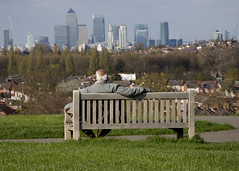 View over Docklands.  Blythe Hill Fields, Honor Oak Park, London (MJ Reilly) Tags: blythehill brockley lewisham croftonpark nikon d7200 nikond7200 bench man seat pensioner honoroakpark london southeastlondon southlondon blythehillfields blythe spring sunshine view londonskyline viewpoint