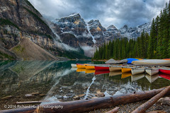 Early morning at Moraine Lake (RichHaig) Tags: banffnationalpark water gitzotripod landscape clouds nikonnikkor1424mmf28 morainelake nationalpark mountains canoes canada richhaig alberta nikond800 snow