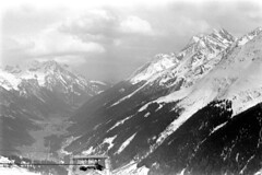 04a3871 25 (ndpa / s. lundeen, archivist) Tags: nick dewolf nickdewolf bw blackwhite photographbynickdewolf film monochrome blackandwhite april 1971 1970s 35mm austria austrian stanton stantonamarlberg tyroleanalps tyrol skitrip skiingtrip alps mountains snow snowcovered slopes skiing skislopes skiresort skiarea tirol alpine valley lift skilift chairlift