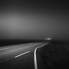 Escape (Vesa Pihanurmi) Tags: road signs car lights trail lighttrail dusk blackandwhite monochrome kirkkonummi line highway transport