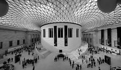 British Museum (stugee) Tags: light shadow people urban bw sun white black london monochrome museum court grid mono noir fuji space crowd culture x shade fujifilm british 12mm noire e2 f20 samyang xe2