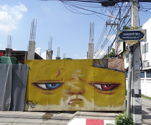 Yellow face on Prapokklao Road - Chiang Mai, Thailand (ashabot) Tags: street streetart yellow thailand graffiti seasia faces cities chiangmai streetscenes