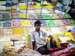 where the sweets have no name (lost_intransit) Tags: portrait india dessert streetphotography portraiture bombay colourful mumbai indianfood mws bandra mithai incredibleindia peopleofindia canoneos500d mymumbai lonelyplanetindia mountmarysteps everydaymumbai tasneempardiwallaphotography