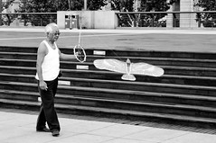 The Kite Dancer (TheWanderingAmerican) Tags: china street old blackandwhite white kite man black bird flying blackwhite shanghai streetphotography indoor  pudong  bund fitzharris  huangpu shanghainese windless      huangpudistrict