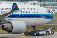 China Southern Airlines Airbus A330-223 B-6547 (861255) (Thomas Becker) Tags: china tractor plane germany airplane geotagged nose deutschland airport nikon raw hessen shot frankfurt aircraft aeroporto southern airbus msn tug gps flughafen aviao nikkor fx airlines flugzeug aeroport aeropuerto tow  ae