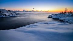 Darkening of a Cold Day (tinamar789) Tags: winter snow sea seashore seascape blue hour horizon hazy rocks sky water suomenlinna helsinki finland
