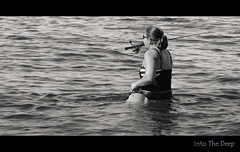 Into the Deep (Poocher7) Tags: monochrome blackandwhite candid portrait people woman blackbathingsuit wading intothedeep water ocean fisherwoman fishing angling rodandreel hooklinesinker ripples carryinteeth blondehair ponytail blackandwhitestripe gulfofmexico usa florida marcoisland southwestflorida
