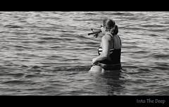 Into the Deep (Poocher7) Tags: monochrome blackandwhite candid portrait people woman blackbathingsuit wading intothedeep water ocean fisherwoman fishing angling rodandreel hooklinesinker ripples carryinteeth blondehair ponytail blackandwhitestripe gulfofmexico usa florida marcoisland southwestflorida