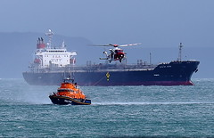 RNLI lifeboat 17-32 (MMSI: 235005118) receiving a crewman from AgustaWestland AW189 (G-MCGS) with Singaporean-registered oil/chemical tanker MTM St Jean (MMSI: 564475000) nearby (petersnapsnap) Tags: with agustawestland crewman 1732 mmsi 235005118 singaporeanregistered oilchemical receiving rnli from tanker lifeboat st jean mtm nearby 564475000 aw189 gmcgs